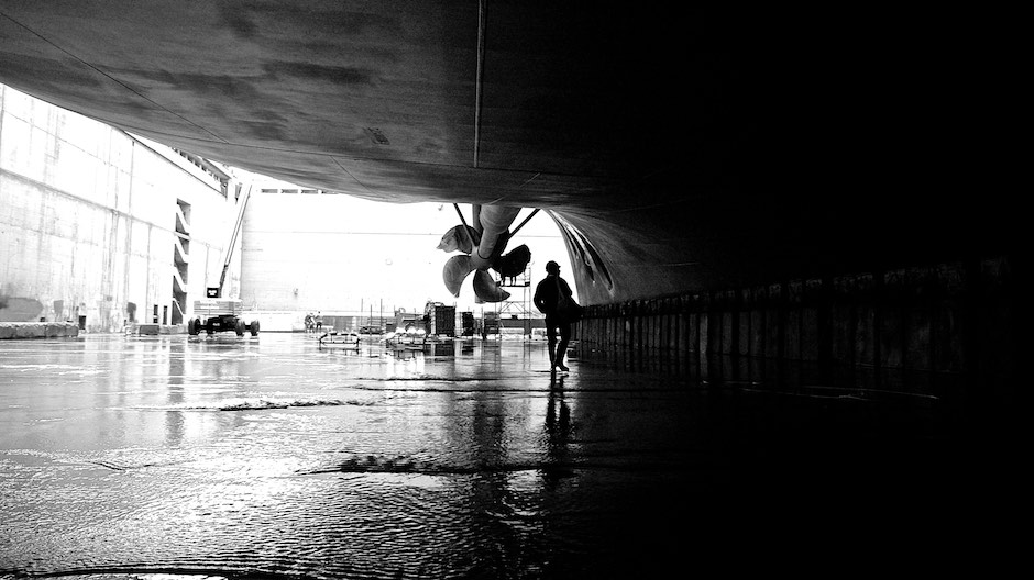 Engineer inspecting the hull of Carnival Freedom ship in dry dock it Trieste.